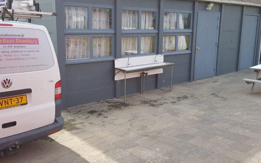 Voorziening om handen te wassen voor, onder strikte voorwaarden, weer op te starten buitentrainingen gereed!